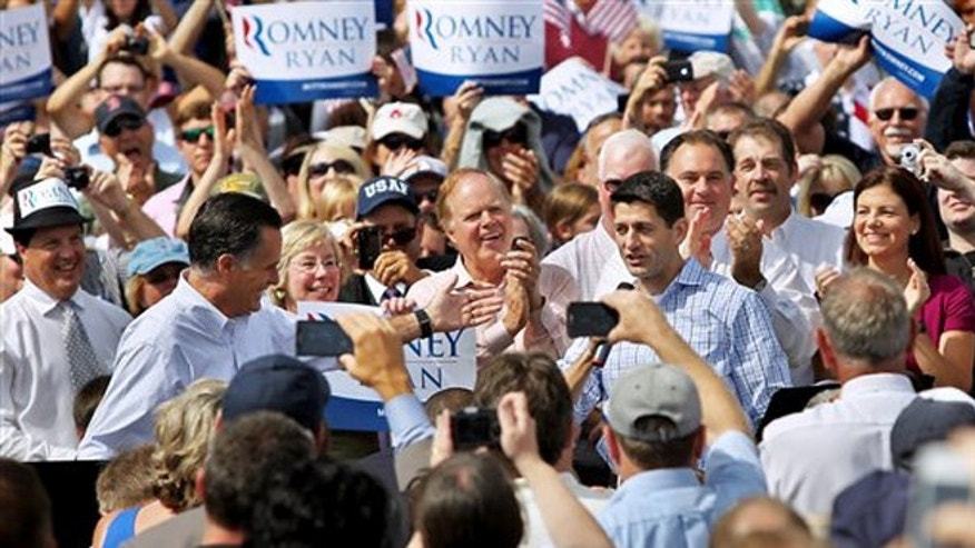 Aug. 20, 2012: Republican presidential candidate Mitt Romney, left, and vice presidential candidate Rep. Paul Ryan, R-Wis., at Saint Anselm College in Manchester, N.H.