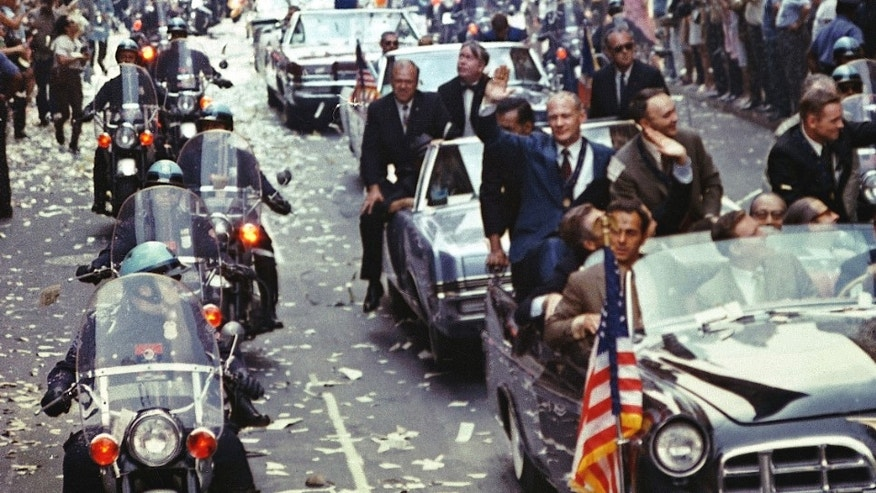 New York City welcomes the Apollo 11 crew in a showering of ticker tape down Broadway and Park Avenue August 13, 1969 in a parade termed as the largest in the city's history. Pictured in the lead car, from the right, are astronauts Neil A. Armstrong, commander; Michael Collins, command module pilot; and Edwin E. Aldrin Jr., lunar module pilot. (Photo by NASA/Newsmakers)