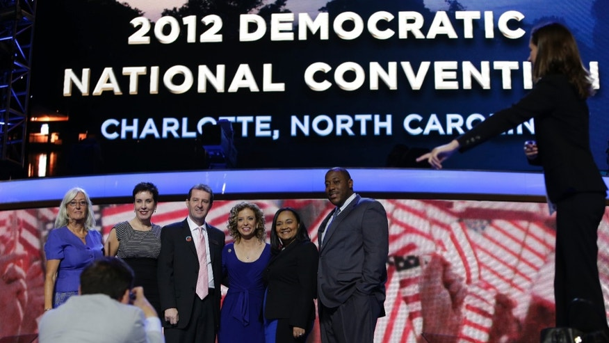 Sept. 2, 2012: The Democratic National Committee chair, Rep. Debbie Wasserman Schultz of Florida, fourth from left, poses for a picture with Georgia delegates on the stage at the Democratic National Convention in Charlotte, N.C.