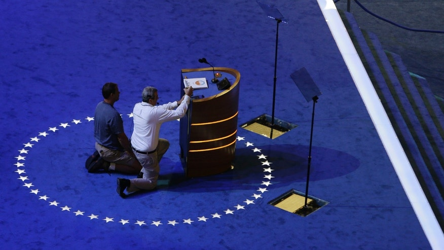 Sept. 2, 2012: Stagehands make final adjustments to the podium on the stage at the Democratic National Convention  inside Time Warner Cable Arena in Charlotte, N.C.