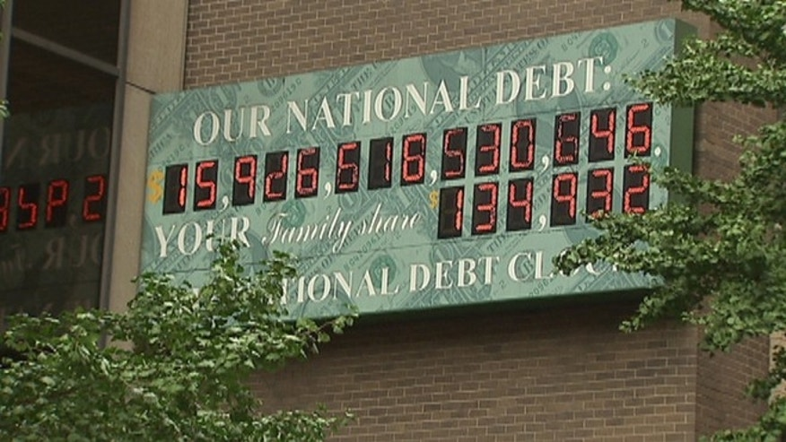 Aug. 17, 2012: The National Debt Clock in Midtown Manhattan shows the federal debt approaching $16 trillion.