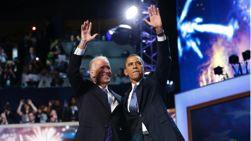 FILE: Sept. 6, 2012: President Obama and Vice President Joe Biden wave at the end of the final session of the Democratic National Convention in Charlotte, North Carolina.