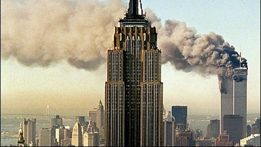 FILE: The twin towers of the World Trade Center burn behind New York's Empire State Building in this Sept. 11, 2001 file photo.  (AP Photo/Marty Lederhandler, File)