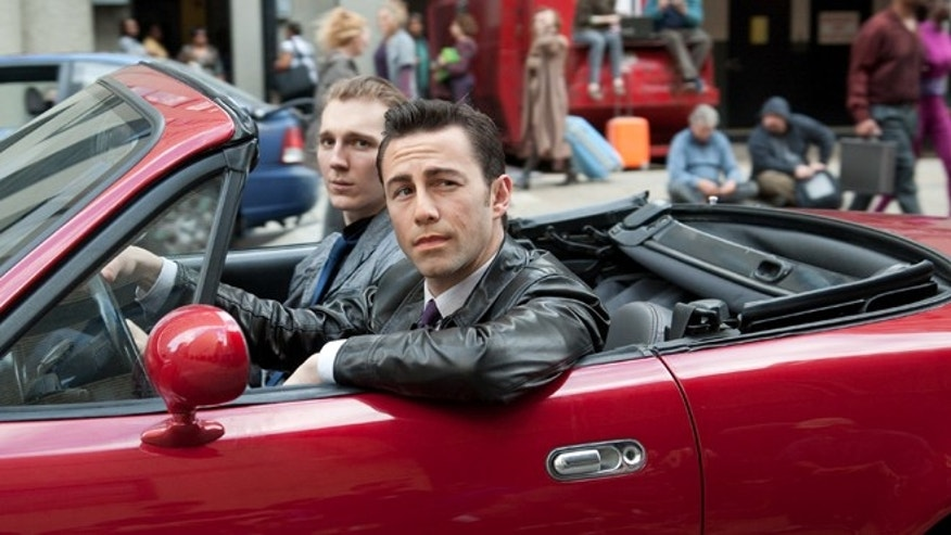 "Joseph Gordon-Levitt, foreground, and Paul Dano in a scene from the action thriller ""Looper"""