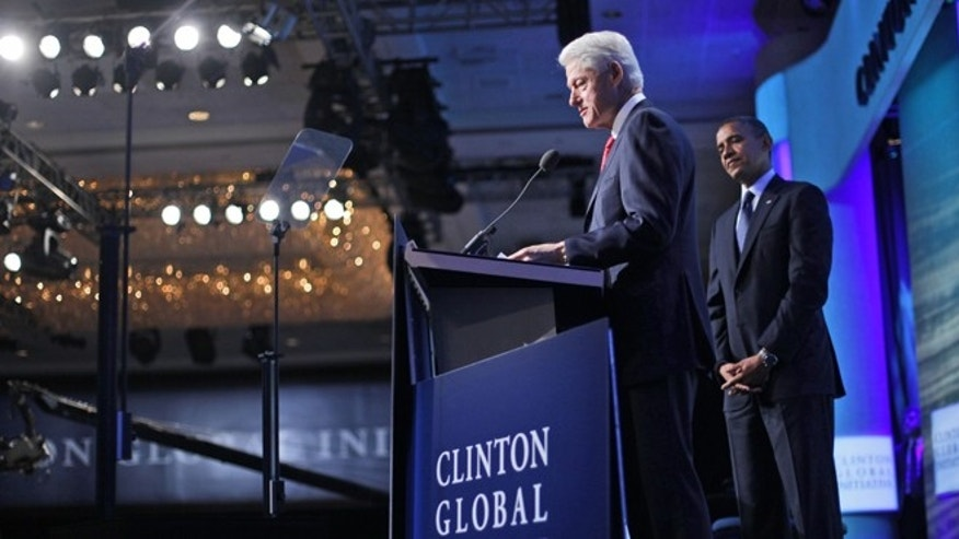 Sept. 25, 2012: Former President Bill Clinton introduces President Barack Obama at the Clinton Global Initiative Annual meeting in New York.