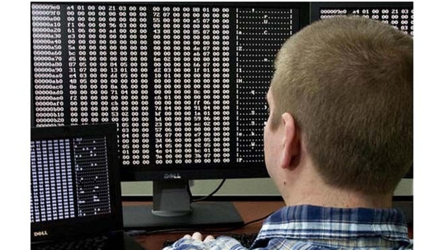 Sept. 29, 2011: A cyber security analyst looks at code in the Malware Laboratory during the first tour of the government's secretive cyber defense lab in Idaho Falls, Idaho.