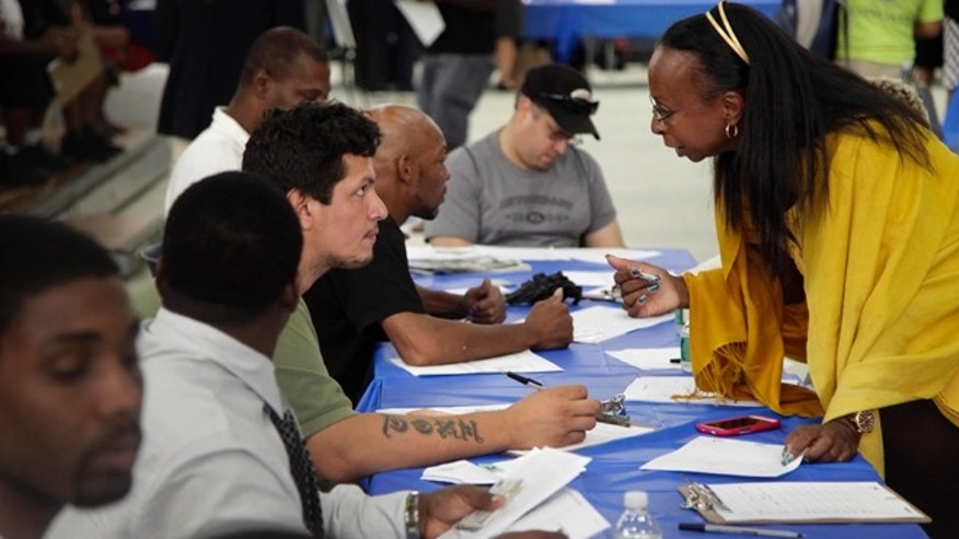Aug. 21, 2012: Job seekers fill out applications at a construction job fair in New York.
