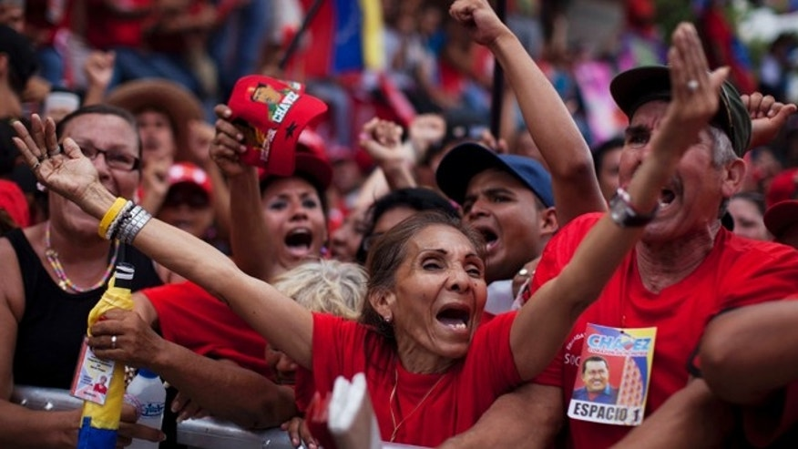 Oct. 3, 2012: Supporters of Venezuela's President Hugo Chavez cheer during a campaign rally in Maracay.