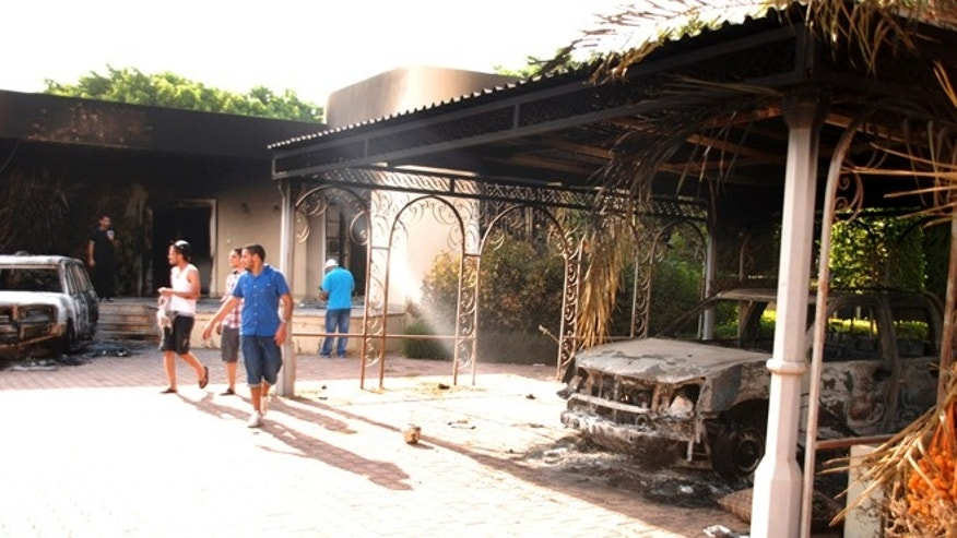 Sept. 12, 2012: Libyans walk on the grounds of the gutted U.S. consulate in Benghazi, Libya, after an attack that killed four Americans, including Ambassador Chris Stevens.