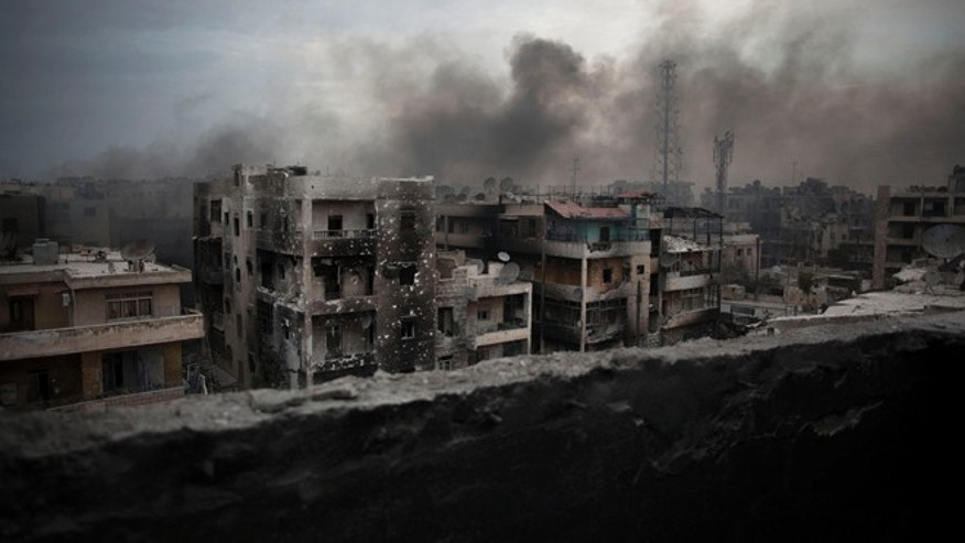 Oct. 2, 2012: Smoke rises over Saif Al Dawla district, in Aleppo, Syria.