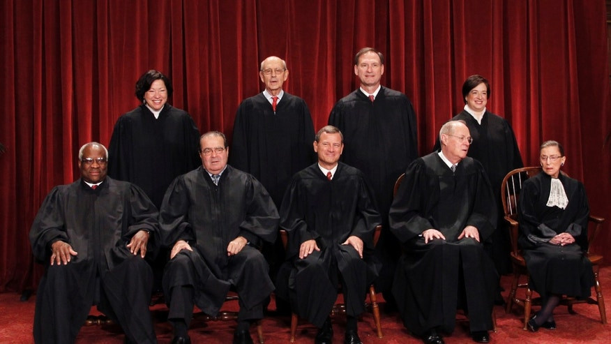 FILE: Oct. 8, 2010:  The high court justices are shown in a group portrait at the Supreme Court Building in Washington.