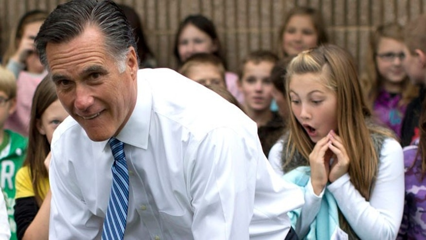 This photo of Mitt Romney posing with students of Fairfield Elementary School in Fairfield, Va., was published Monday by the Associated Press.