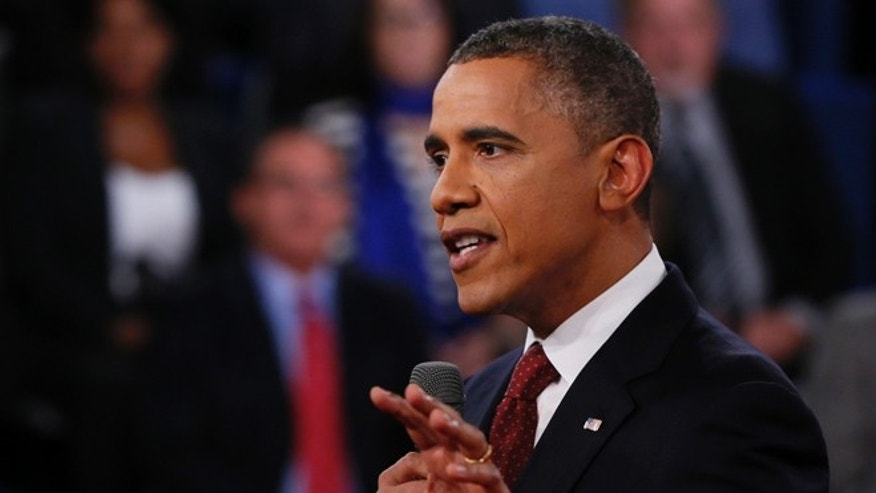 Oct. 16, 2012: President Barack Obama addresses members of the audience during the second presidential debate with Republican presidential nominee Mitt Romney at Hofstra University.