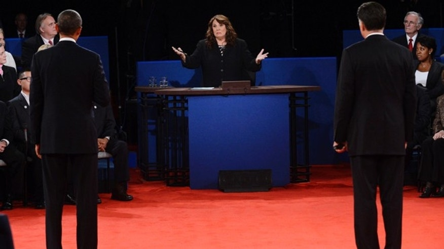 Oct. 16, 2012: Moderator Candy Crowley, center, addresses President Barack Obama, left, and Republican presidential nominee Mitt Romney during the second presidential debate.