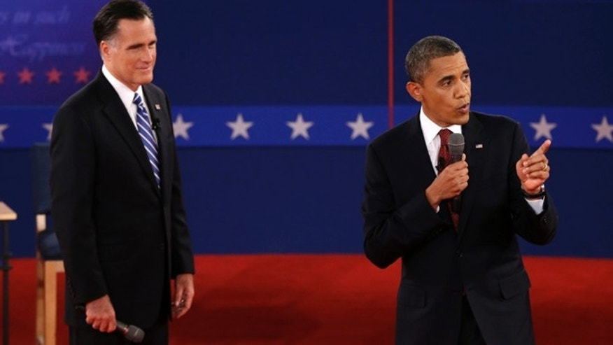 Oct. 16, 2012: Republican presidential nominee Mitt Romney listens as President Barack Obama speaks during the second presidential debate.