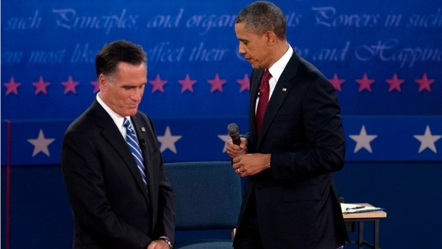 President Barack Obama and Republican presidential candidate, former Massachusetts Gov. Mitt Romney, pause as they participate in the second presidential debate, Tuesday, Oct. 16, 2012, at Hofstra University in Hempstead, N.Y. (AP Photo/Carolyn Kaster)