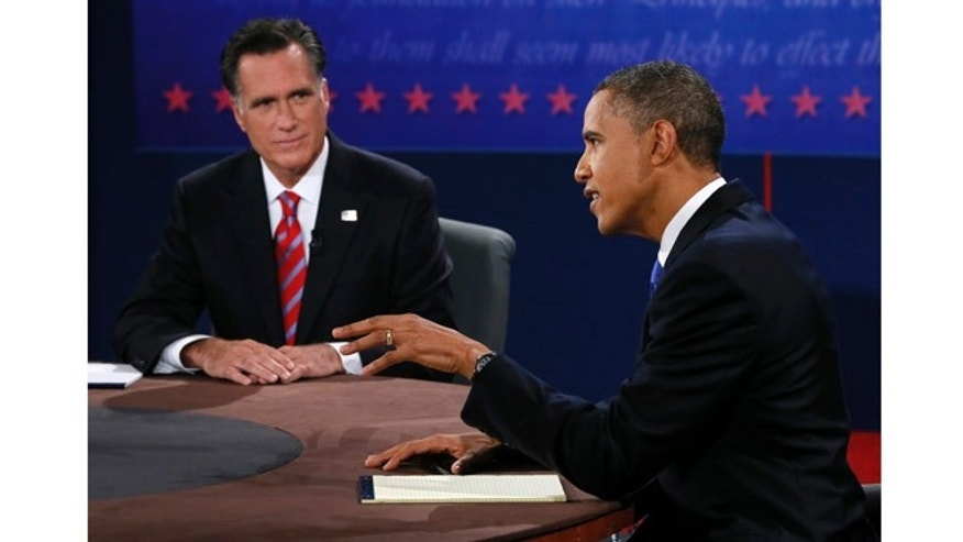 Oct. 22, 2012: Republican presidential nominee Mitt Romney listens to President Barack Obama speak during the third presidential debate.