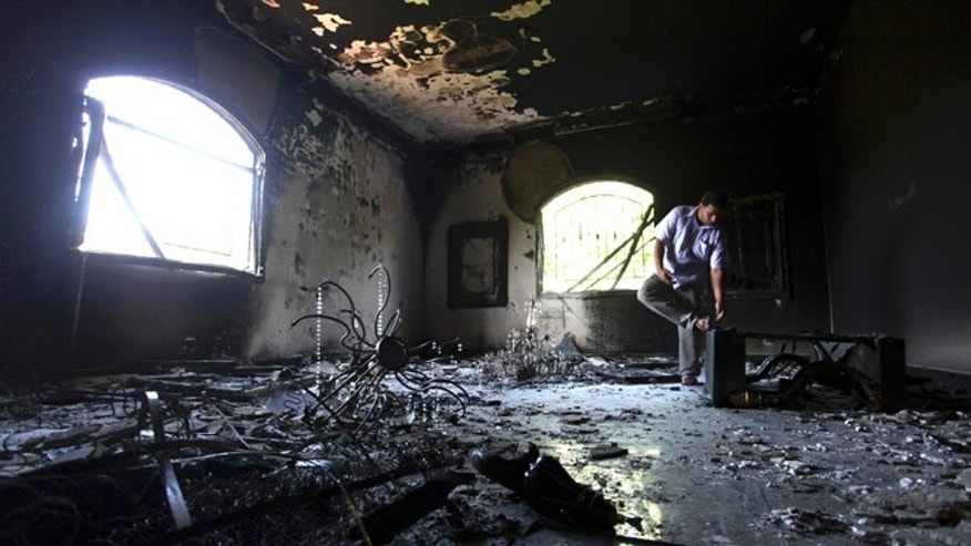 File: Sept. 13, 2012: A Libyan man investigates the inside of the U.S. Consulate.