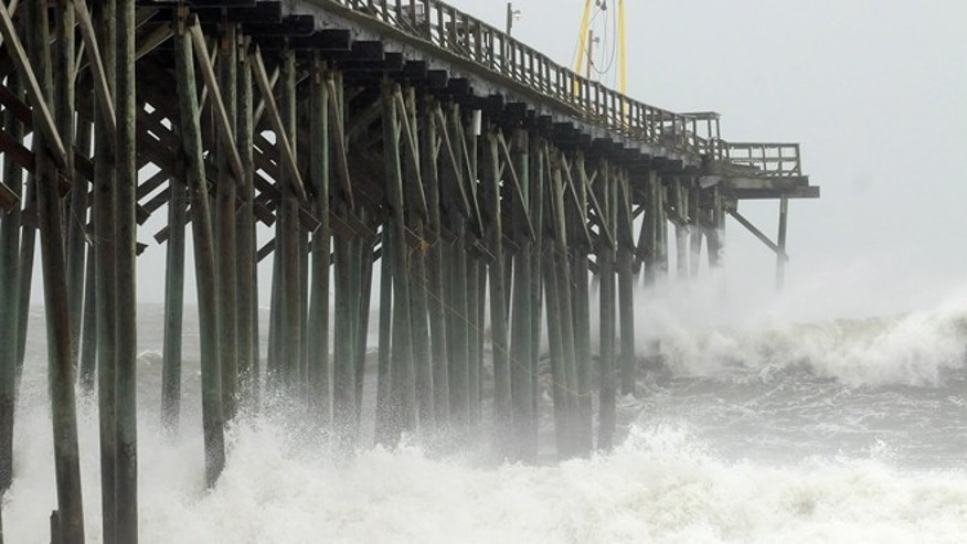 Oct. 27, 2012: Waves pound Carolina Beach pier in Carolina Beach, N.C., as Hurricane Sandy churns in the Atlantic Ocean.