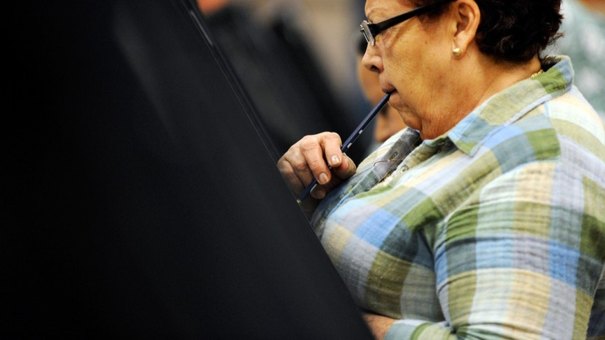 LAS VEGAS, NV - OCTOBER 20:  Voting for the first time, Maria Conception ponders her vote as she casts her ballot during the first day of early voting in Nevada at the East Las Vegas Community Center polling station October 20, 2012 in Las Vegas, Nevada. Early voting continues in the battleground state of Nevada until November 2 with election day on November 6.  (Photo by David Becker/Getty Images)