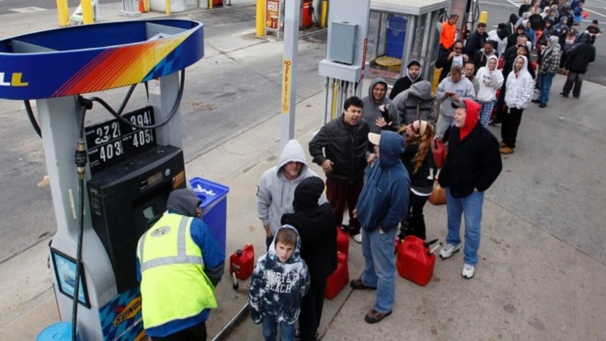 People line up to fill gas containers at the New Jersey Turnpike's Thomas A. Edison service area Wednesday, Oct. 31, 2012, near Woodbridge, N.J. After Monday's storm surge from Sandy, many gas stations in the region are without power and those that are open have very long lines. (AP Photo/Mel Evans)
