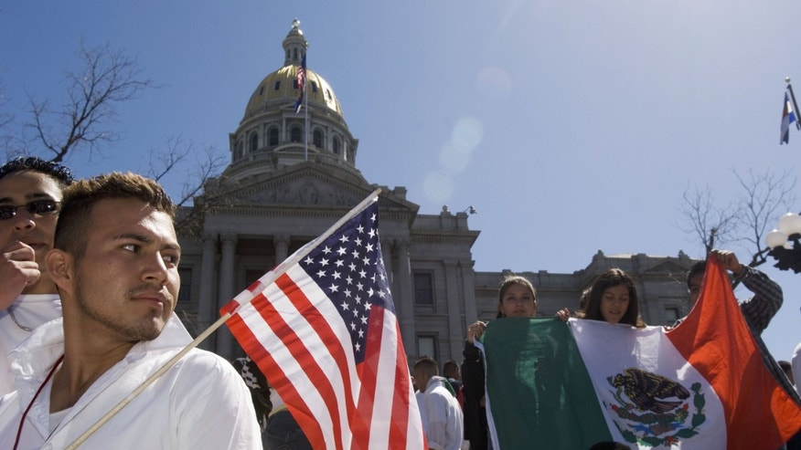 DENVER - APRIL 19:  Adrian Campos, 16, holds a U.S. flag during a rally with about 3,000 middle and high school students who walked out of school April 19, 2006 in Denver, Colorado. The students gathered on the steps of the Colorado state Capitol to demonstrate in support of immigrant rights and against U.S. Congressional immigration reform proposals.  (Photo by Kevin Moloney/Getty Images)
