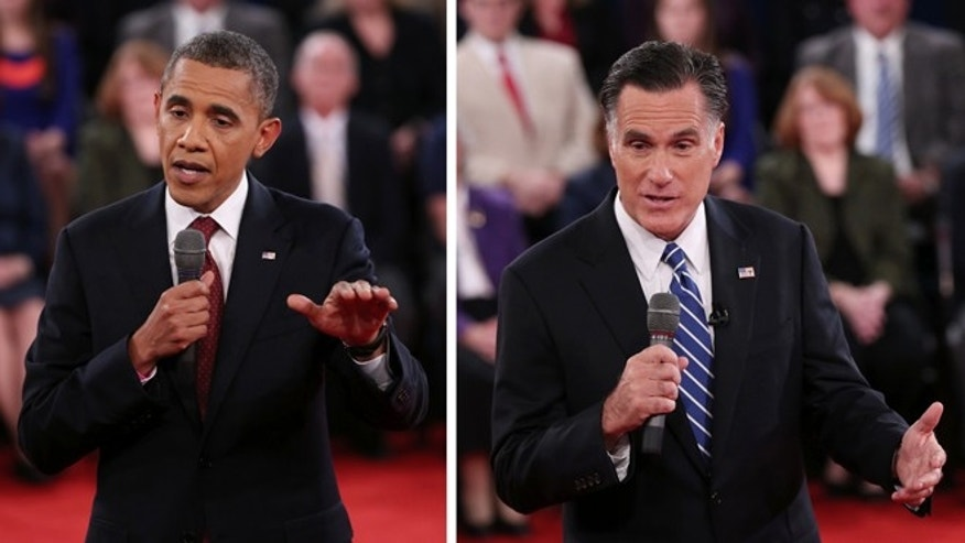 Oct. 16, 2012: President Barack Obama, left, and Republican presidential nominee Mitt Romney address the audience during the second presidential debate at Hofstra University.