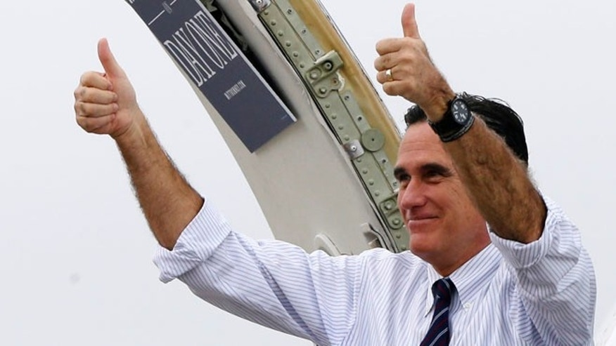 Nov. 5, 2012: Republican presidential candidate, former Massachusetts Gov. Mitt Romney gives two thumbs up as he boards his campaign plane.