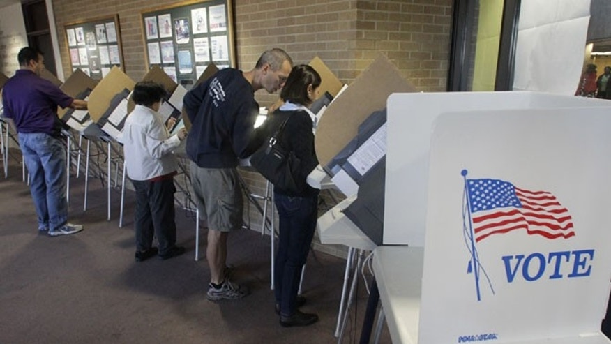 Oct. 30, 2012: People vote early at the Salt Lake County Government Building in Salt Lake City.