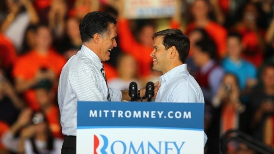 Mitt Romney is greeted by Marco Rubio in Miami, Florida.