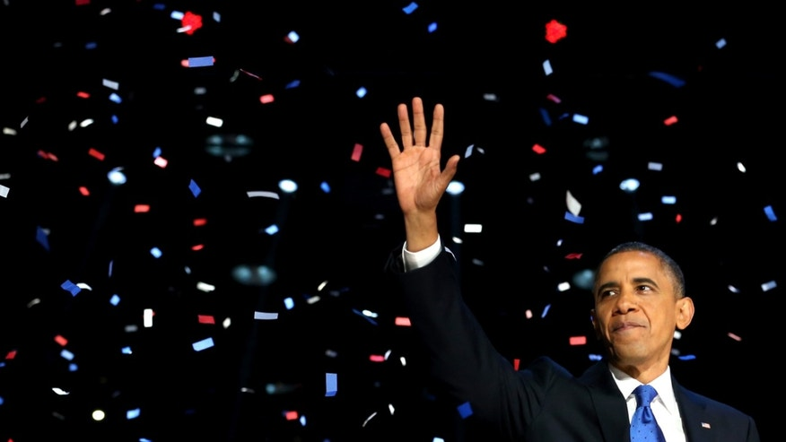 Nov. 6, 2012:  U.S. President Barack Obama waves to supporters after his victory speech at McCormick Place on election night in Chicago, Illinois.