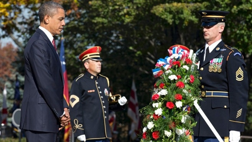 Nov. 11, 2012: President Barack Obama presents a wreath at the Tomb of the Unknowns at Arlington National Cemetery during a Veterans Day ceremony in Arlington, Va.