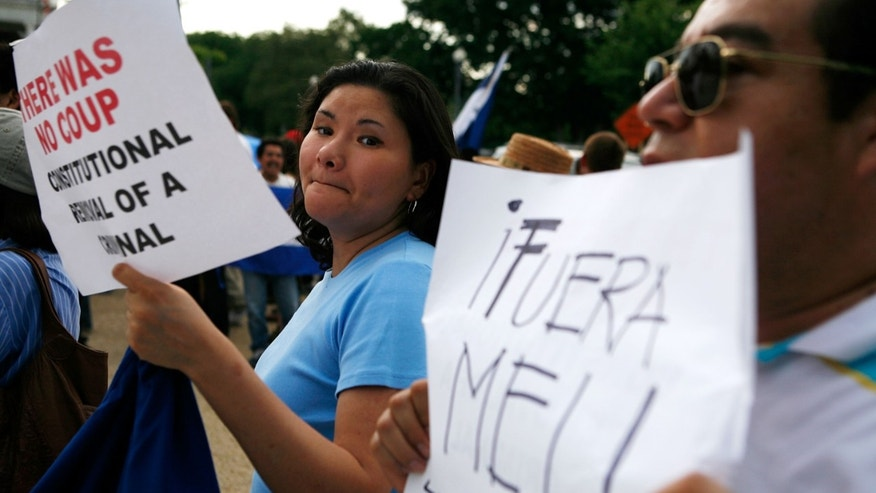 WASHINGTON - JUNE 30:  Demonstrators counter-protest against supporters of ousted Honduran President Manuel Zelaya outside the Organization of American States June 30, 2009 in Washington, DC. The former Honduran leader was expected to attend a special session that the General Assembly of OAS has called to discuss the coup that sent him into exile.  (Photo by Alex Wong/Getty Images)