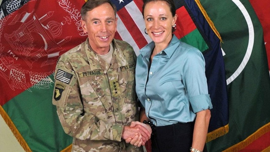 "July 13, 2011: Former Commander of International Security Assistance Force and U.S. Forces-Afghanistan Gen. Davis Petraeus, left, shakes hands with Paula Broadwell, co-author of his biography ""All In: The Education of General David Petraeus."" (AP/ISAF)"