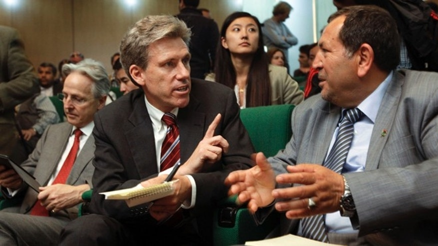 FILE: April 11, 2011: U.S. Ambassador Chris Stevens, center, speaks to Council member for Misrata Suleiman Fortia, right, at the Tibesty Hotel  in Benghazi, Libya.