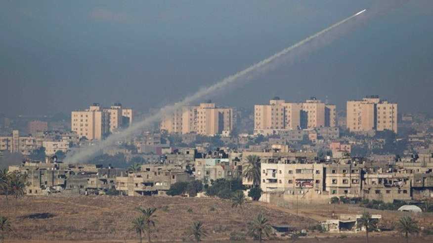 Nov. 15, 2012: A rocket launched by Palestinian militants towards Israel makes its way from the northern Gaza Strip, seen from the Israel Gaza Border, southern Israel.