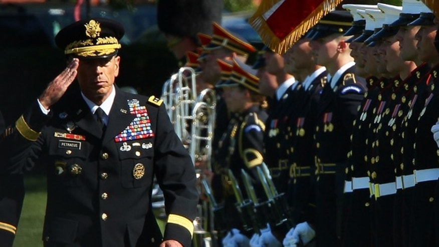 FORT MYER, VA - AUGUST 31:  U.S.  Gen. David Petraeus (L) inspects troops during an Armed Forces Farewell Tribute and Retirement Ceremony August 31, 2011 at Ft. Myer, Virginia.  Petraeus  is leaving the U.S. Army after 37 years in the service to serve as  the new Director of the Central Intelligence Agency.  (Photo by Win McNamee/Getty Images)