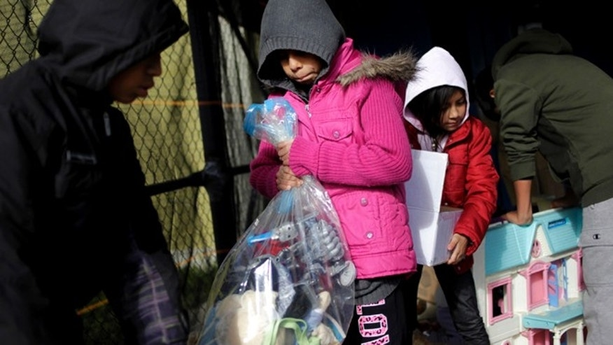 Nov. 5, 2012: Samantha Pavia, 9, second from left, looks through toys at a donation site in the Midland Beach section of Staten Island, New York, Monday,. Pavia lost most of her belongings, including her toys, when Storm Sandy flooded her home and forced her family to evacuate.