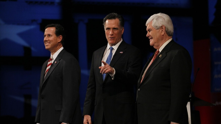 TAMPA, FL - JANUARY 23:  (L - R) Republican presidential candidates former U.S. Sen. Rick Santorum, former Massachusetts Gov. Mitt Romney, and former Speaker of the House Newt Gingrich (R-GA) appear before the NBC News, National Journal, Tampa Bay Times GOP debate held at the University of South Florida on January 23, 2012 in Tampa, Florida. The debate is the first of two before the Florida primaries on January 31.  (Photo by Joe Raedle/Getty Images)