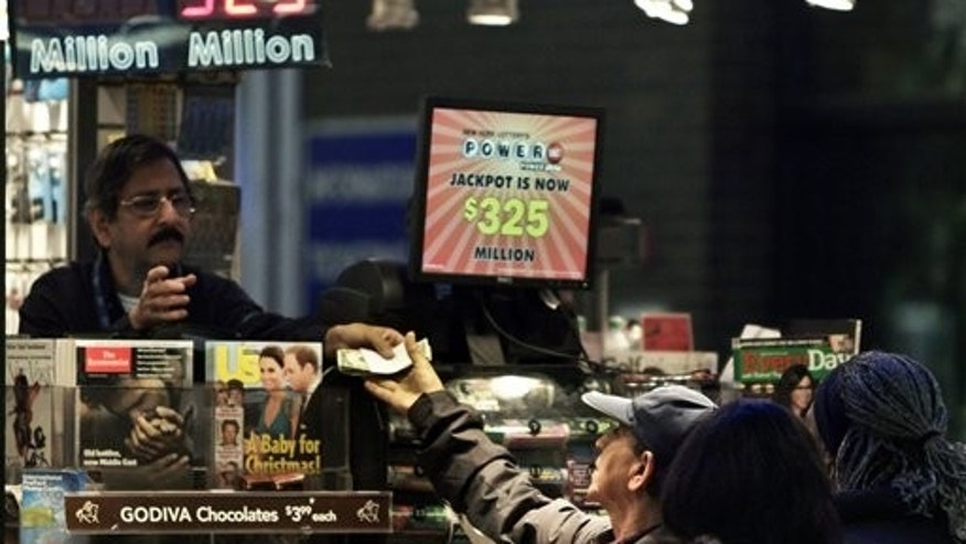 A vendor, left, receives money for a lottery purchase in New York.