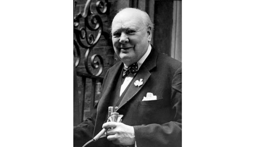 June 24, 1952: Sir Winston Churchill smiles at the front door of 10 Downing Street, London.