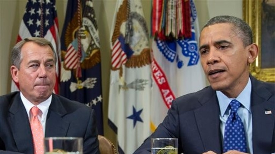 This Nov. 16, 2012 file photo shows President Barack Obama, accompanied by House Speaker John Boehner of Ohio, speaking to reporters in the Roosevelt Room of the White House in Washington, as he hosted a meeting of the bipartisan, bicameral leadership of Congress to discuss the deficit and economy in Washington.