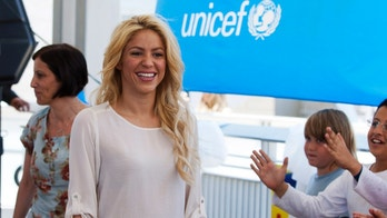 JERUSALEM, ISRAEL - JUNE 21: (ISRAEL OUT) Colombian singer and UNICEF Goodwill ambassador Shakira meets with Israeli and Palestinian school children during her visit to a Bilingual school on June 21, 2011 in Jerusalem, Israel. The pop star is due to meet with President Shimon Peres and take part in a panel with comedian Sarah Silverman. (Photo by David Vaaknin/Getty Images)
