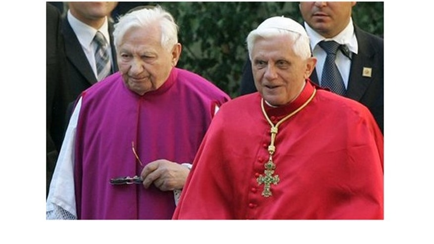In this Sept. 13, 2006, picture, Pope Benedict XVI, right, walks with his brother priest Georg Ratzinger in Regensburg, southern Germany.