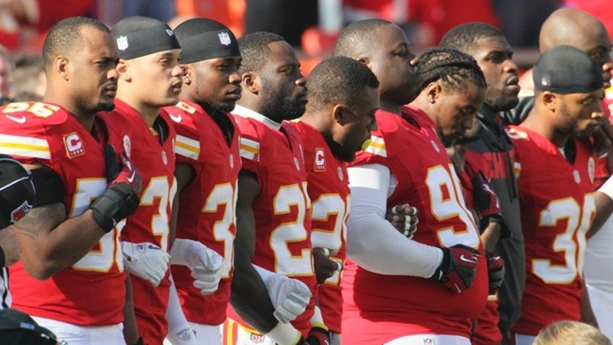Dec. 2, 2012: Kansas City Chiefs players stand arm-in-arm during a moment of silence before an NFL football game against the Carolina Panthers at Arrowhead Stadium in Kansas City, Mo.
