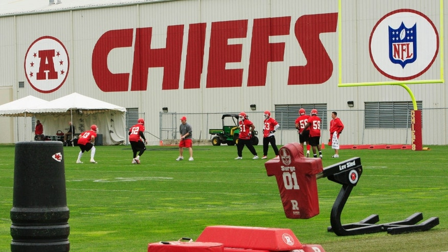 In this photo, Kansas City Chiefs football players work out during an NFL football mini camp at the team's practice facility in Kansas City, Mo.