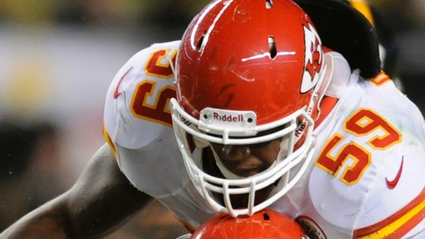 Nov. 12, 2012: Pittsburgh Steelers' Jonathan Dwyer (27) is stopped by Kansas City Chiefs' Jovan Belcher (59) and Justin Houston (50) during the fourth quarter of their NFL football game in Pittsburgh, Pennsylvania.
