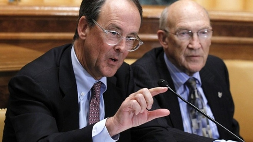 Nov. 10, 2010: Erskine Bowles, left, accompanied by former Wyoming Sen. Alan Simpson, co-chairmen of President Obama's bipartisan deficit commission, gestures while speaking on Capitol Hill in Washington.