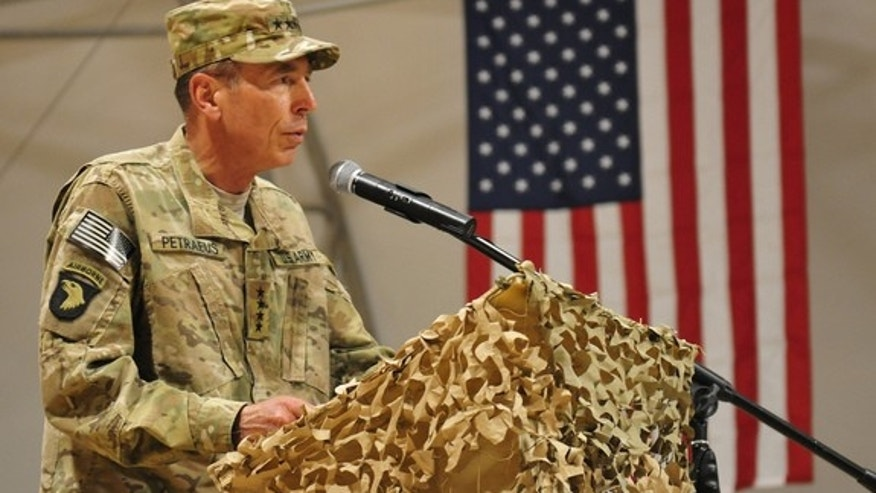 Now-retired U.S. Army Gen. David Petraeus addresses service members during a reenlistment ceremony at Kandahar Airfield, Afghanistan, July 4, 2011 before he left the military to head the CIA.