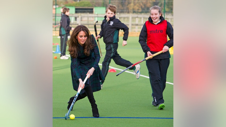 "Kate, the Duchess of Cambridge, left,  plays hockey during her visit to St. Andrews School, where she  attended school from 1986 till 1995, in Pangbourne, England, Friday, Nov. 30, 2012. The Duchess of Cambridge has gone back to school. The royal, formerly known as Kate Middleton, played hockey and revealed her childhood nickname  Squeak  when she returned to her elementary school for a visit Friday. Kate told teachers and students at the private St. Andrew's School in southern England that her 10 years there were ""some of my happiest years."" She said that she enjoyed it so much that she had told her mother she wanted to return as a teacher. (AP Photo/Arthur Edwards, Pool)"